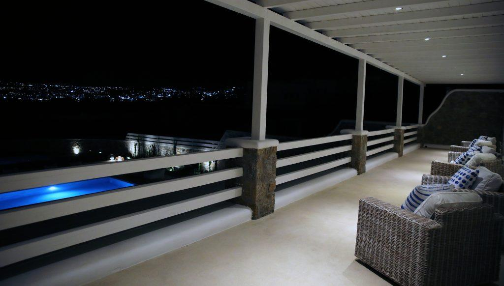 terrace view at night on pool and city lights
