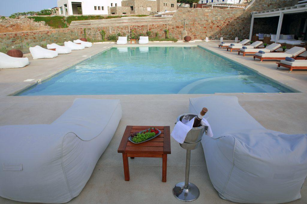 outdoor area with sunbeds wine and fruit to enjoy after swim