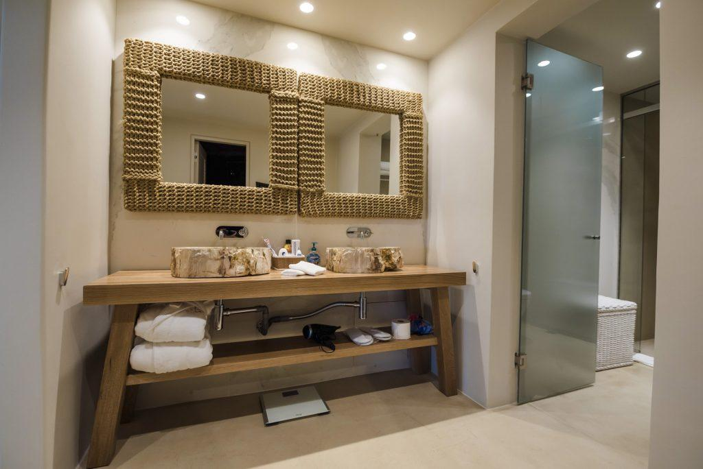 bathroom with two framed mirrors for couples