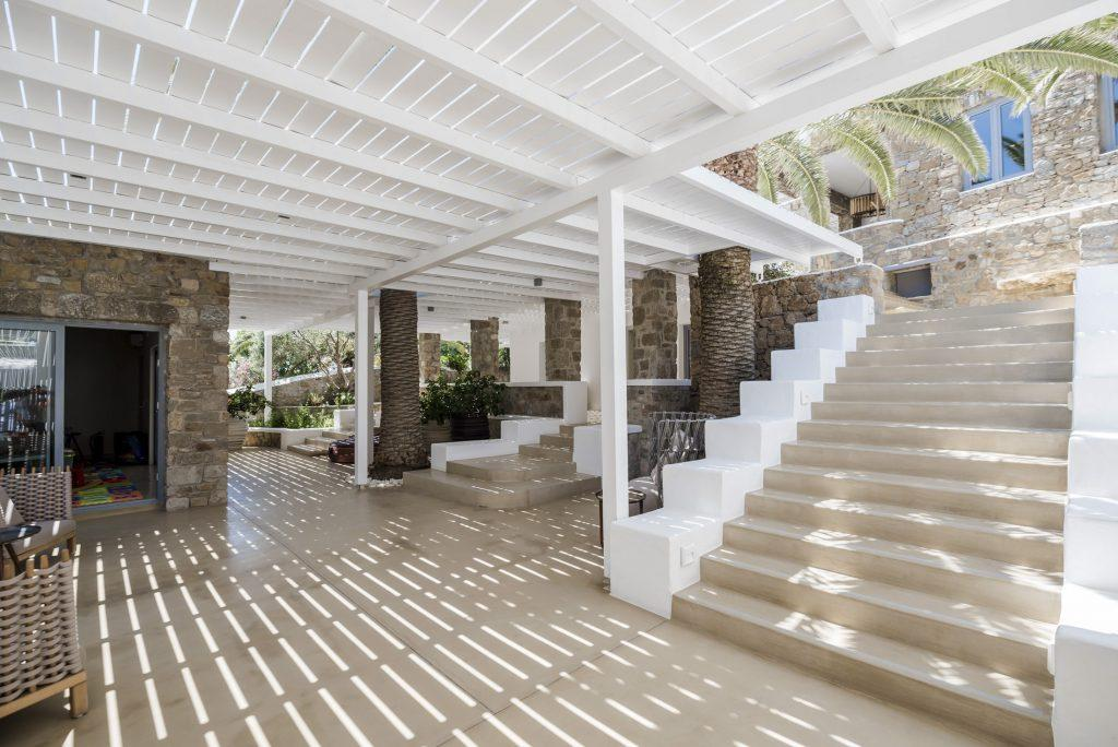 outside of the villa with stone walls and stairs