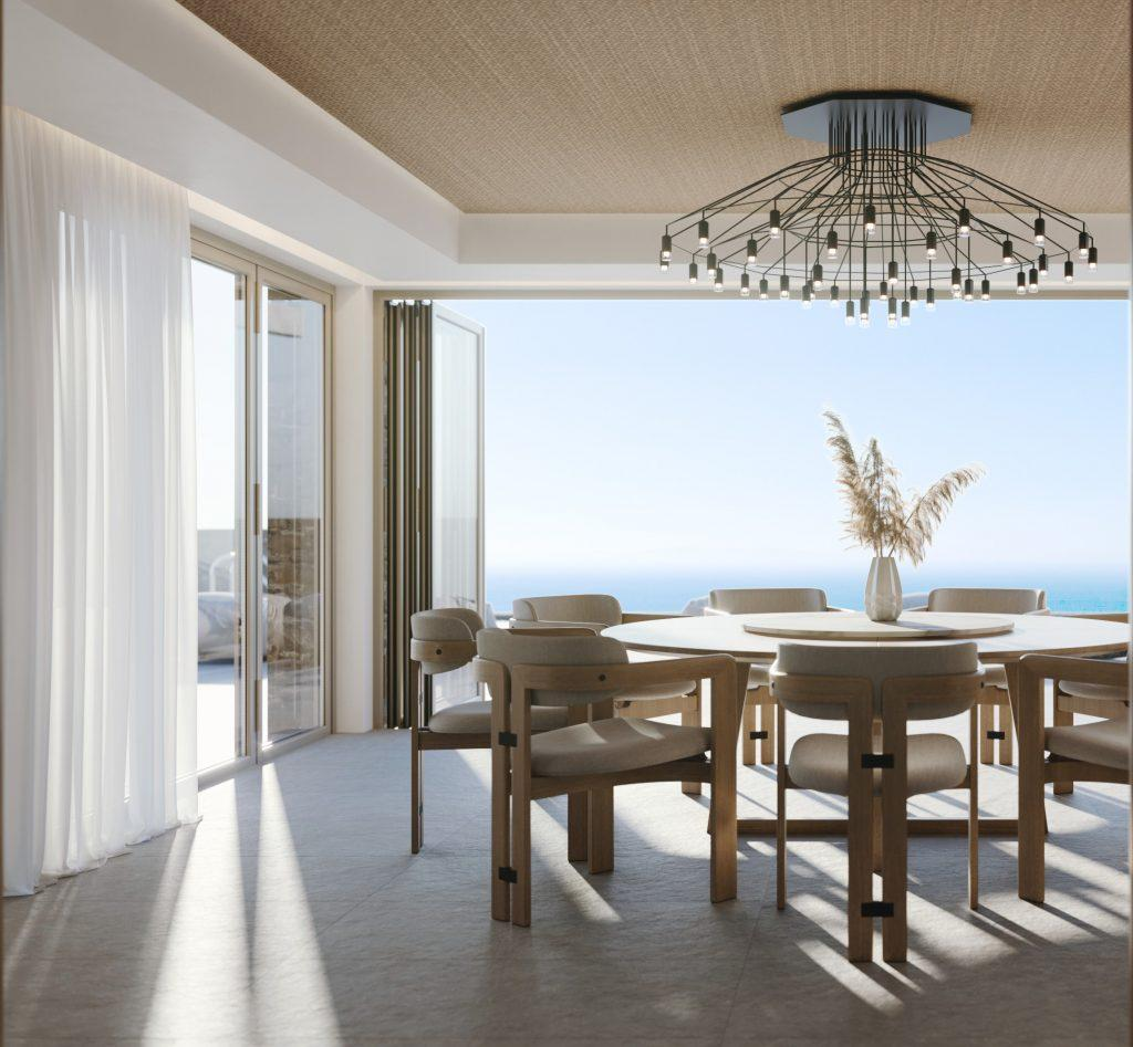 dining area with round table and nice designed wall lamp