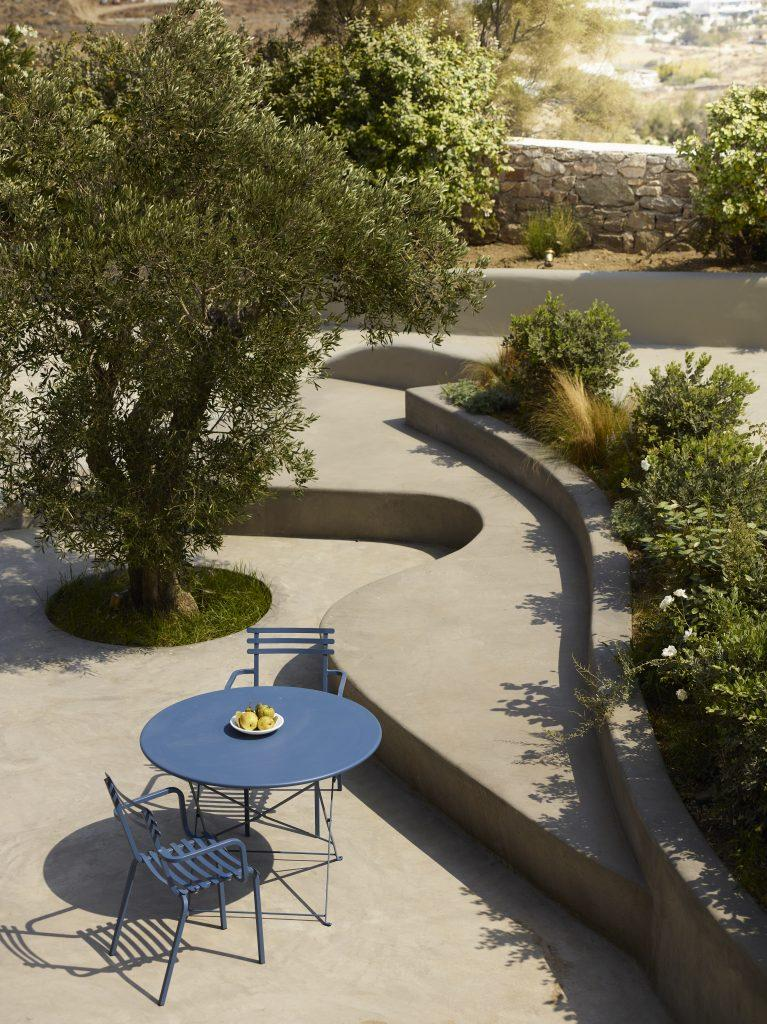 outdoor place surrounded with a lot of greenery perfect for morning coffee with your partner