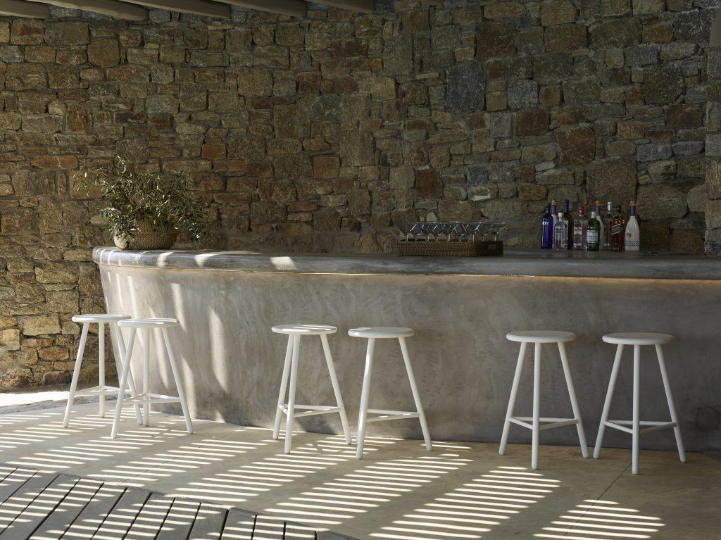 spacious outdoor bar with a lot of bar stools to sit down with your friends and mix cocktails