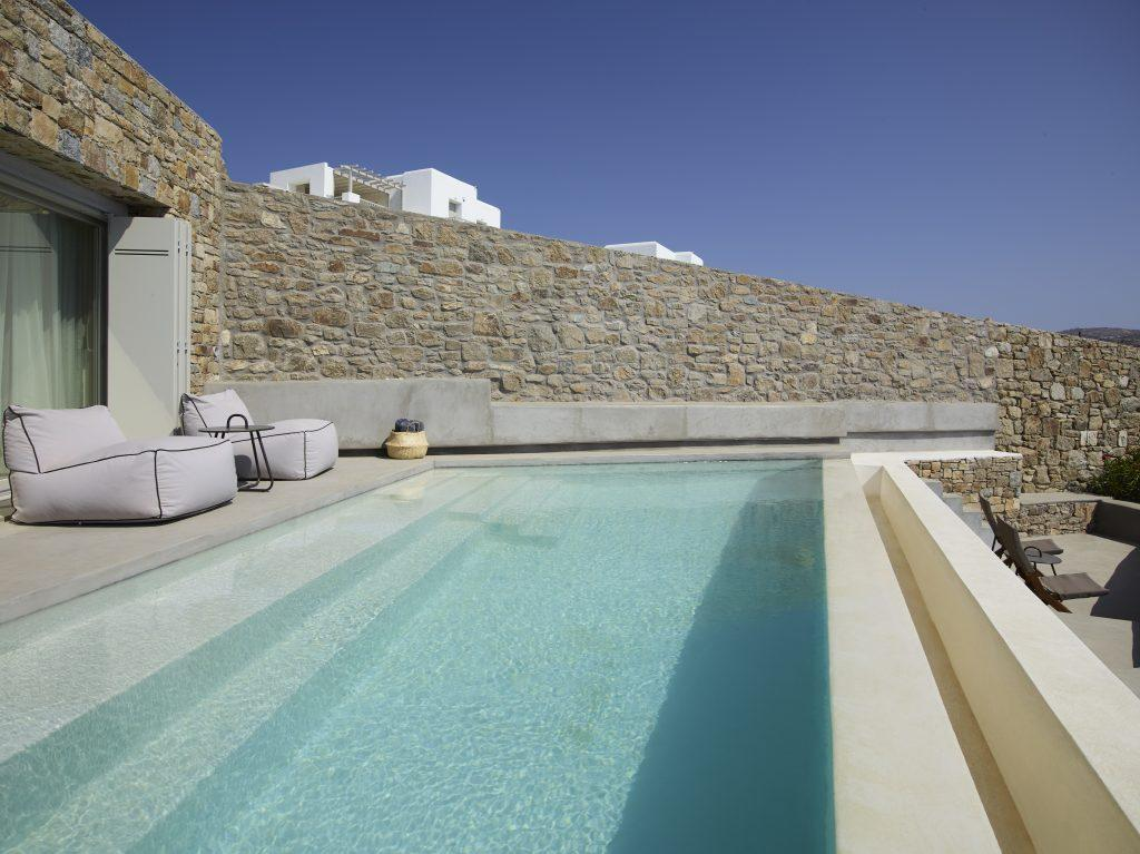 ideal place to sunbath and get perfect tan with your friends in next to pool easy chairs