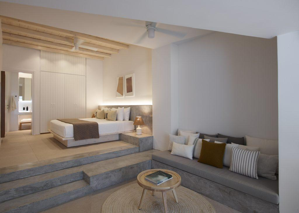 big bedroom for sleeping and chilling on sofa with extra cozy cushions