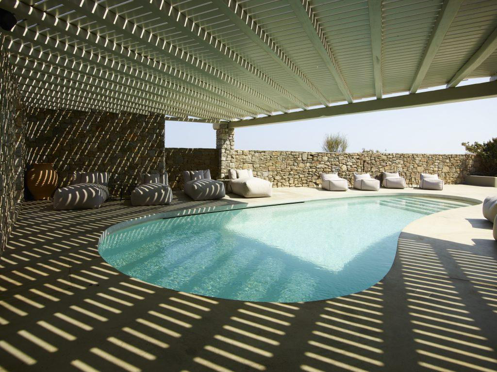 perfect place to relax in or out of the pool in the shade or the sun