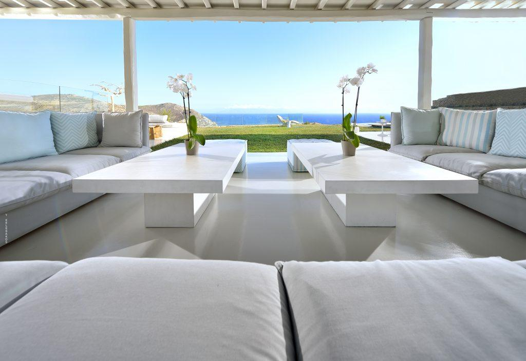 outdoor chilling area with huge couch and tables with beautiful view