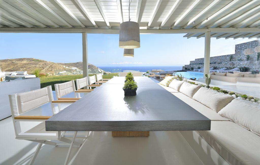 outdoor dining area with big table and chairs perfect for dinner with friends and family