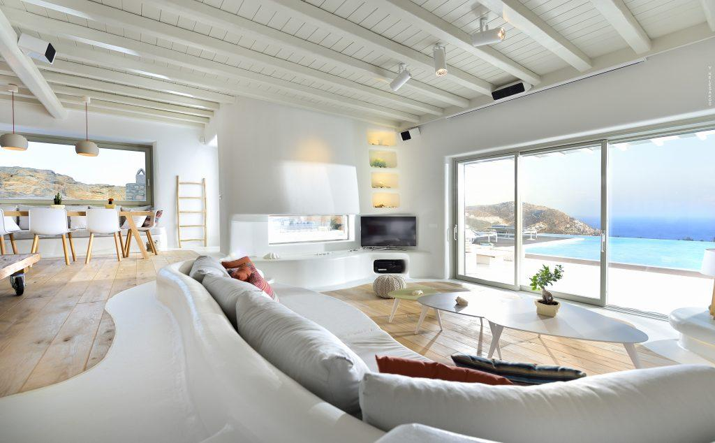 living area with big cozy couch perfect for gatherings with pleasant sea view