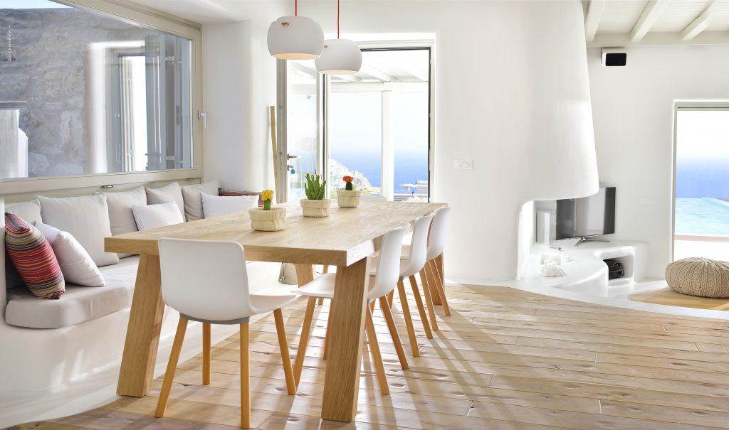 dining area with wooden table and chairs with beautiful view