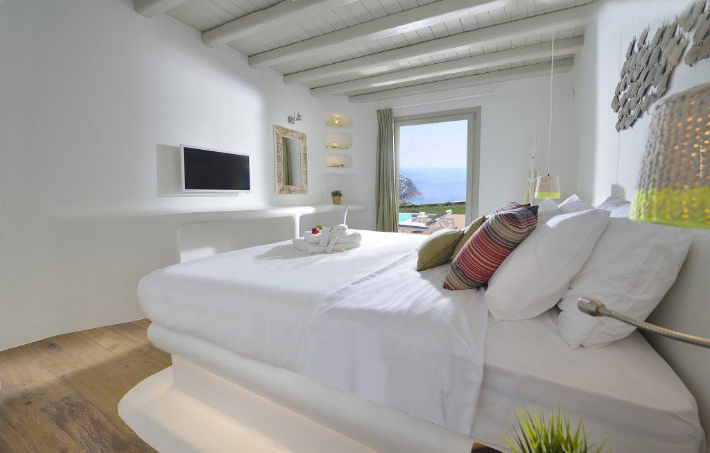white wall bedroom perfect for relaxing and watching television with beautiful view