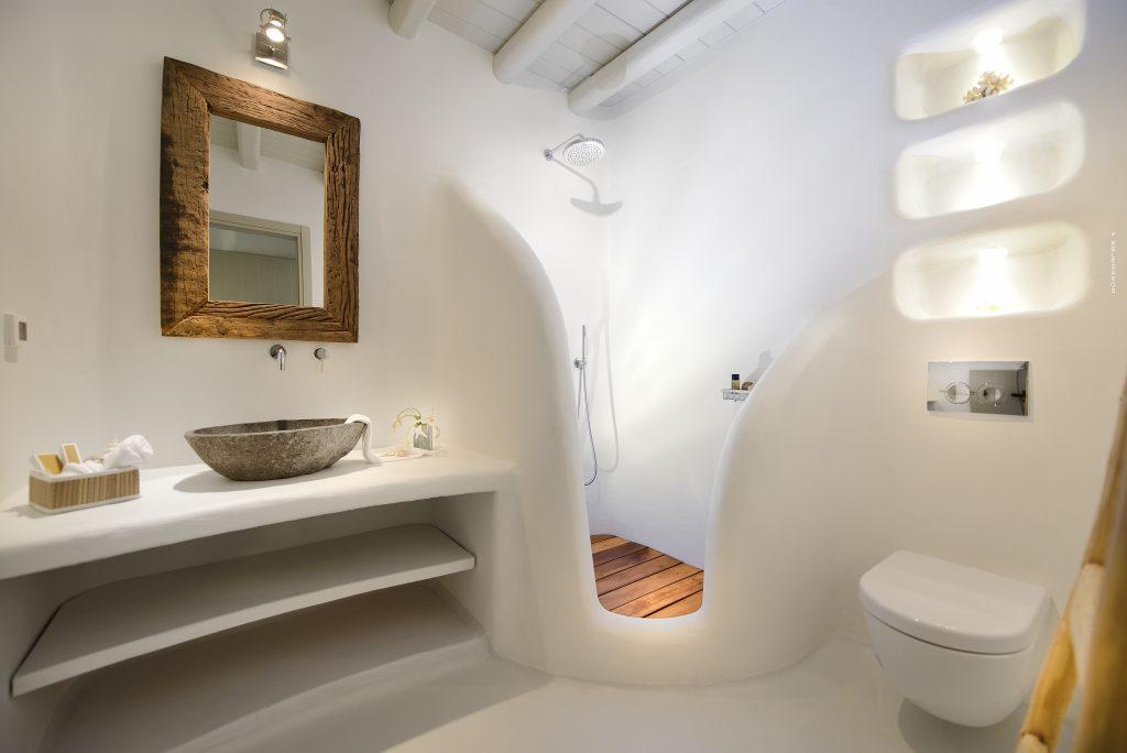 modern designed bathroom with white walls and square mirrors