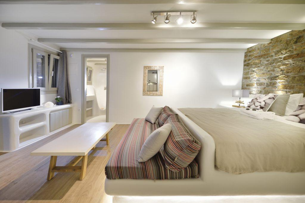 spacious bedroom for two to relax after exhausting day
