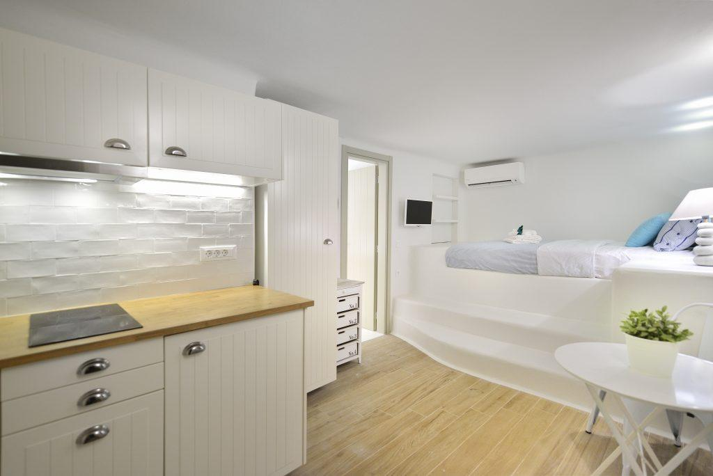 apartment with high bed with air conditioning and prepare favourite meals