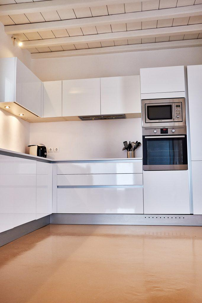 modern designed kitchen with white painted drawers and shelves