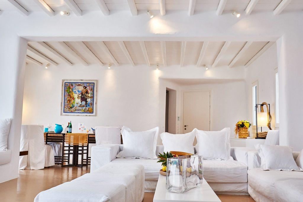 white wall living area with couch and soft pillows