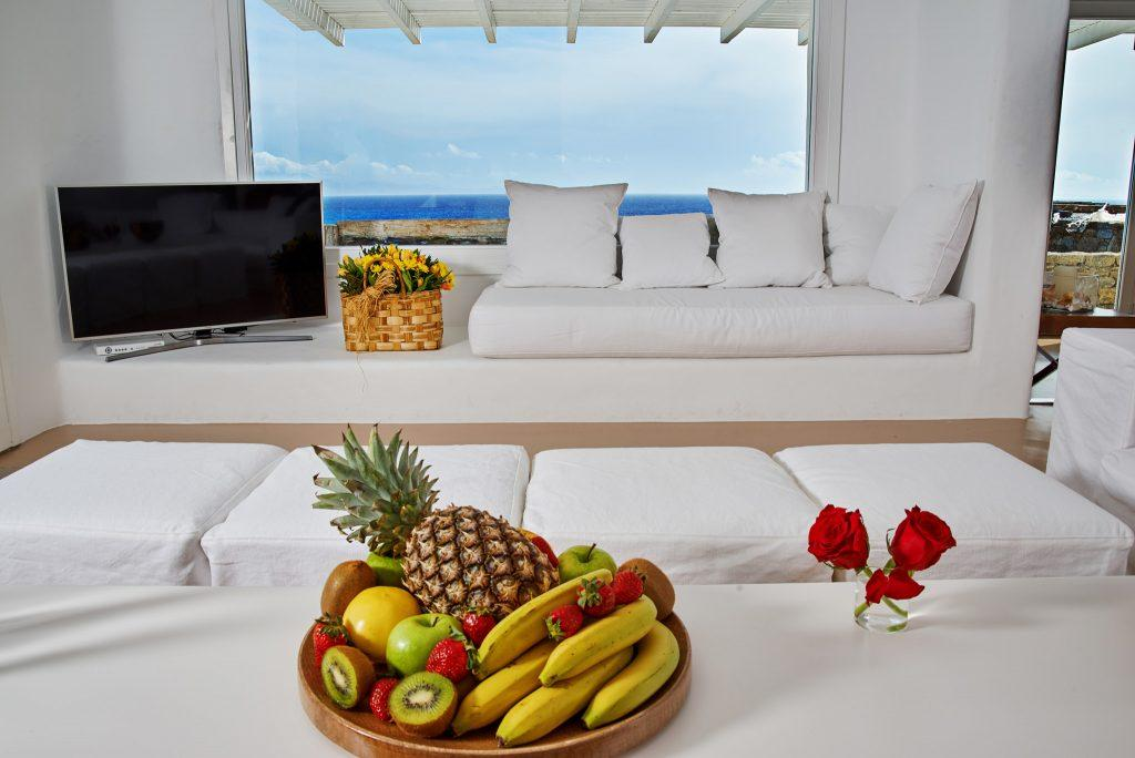 white wall living area with perfect horizon view from the windows