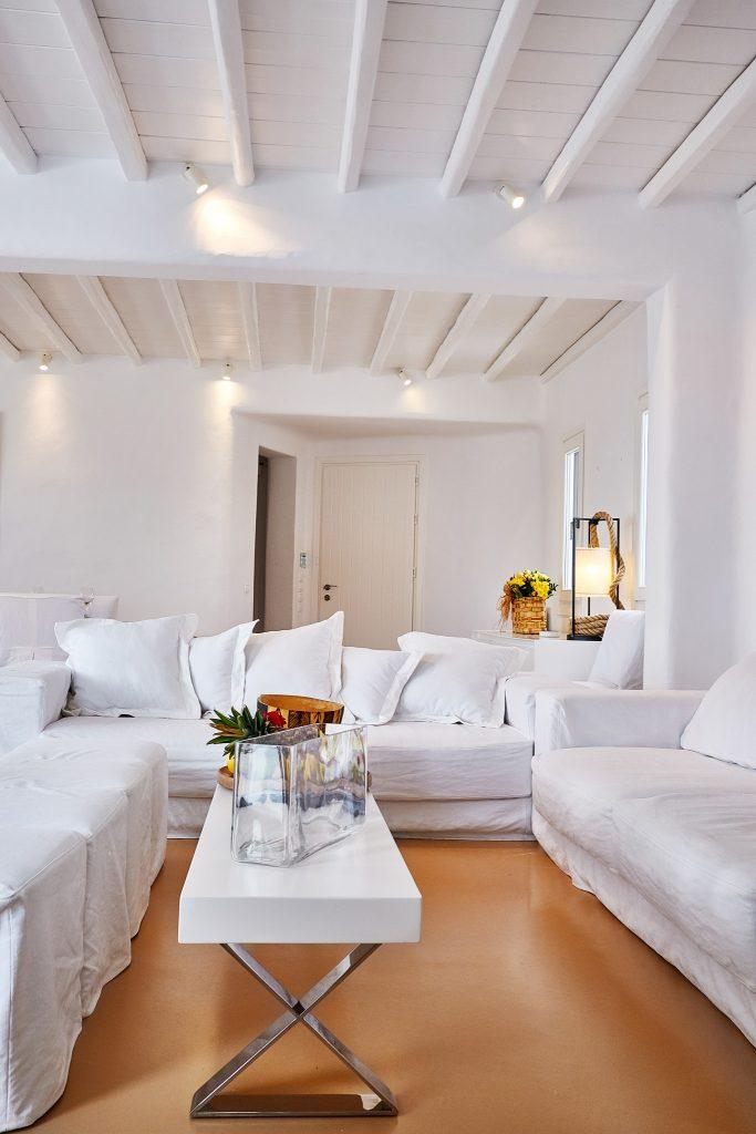 white wall living room with square wooden table and glass vase