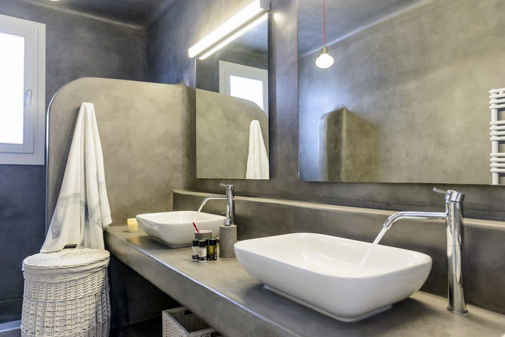 modern designed bathroom with grey walls and square mirrors