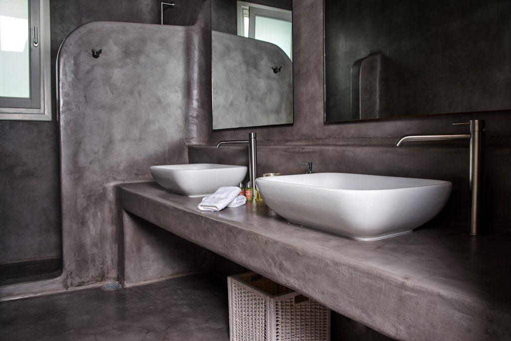 luxurious bathroom with square mirrors and ceramic sinks