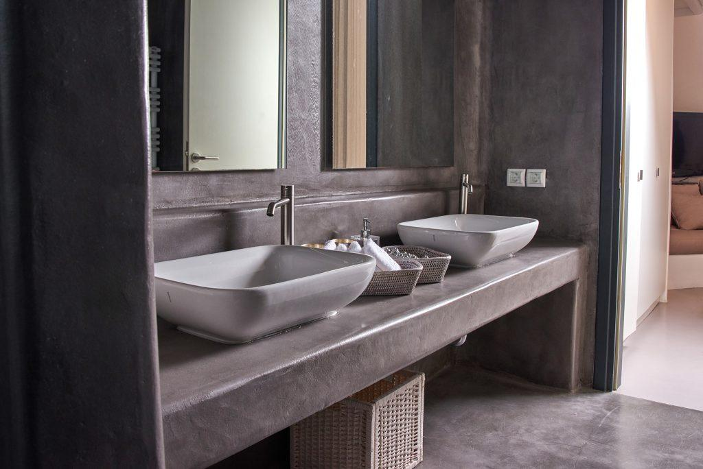 grey bathroom with ceramic sinks and square mirrors