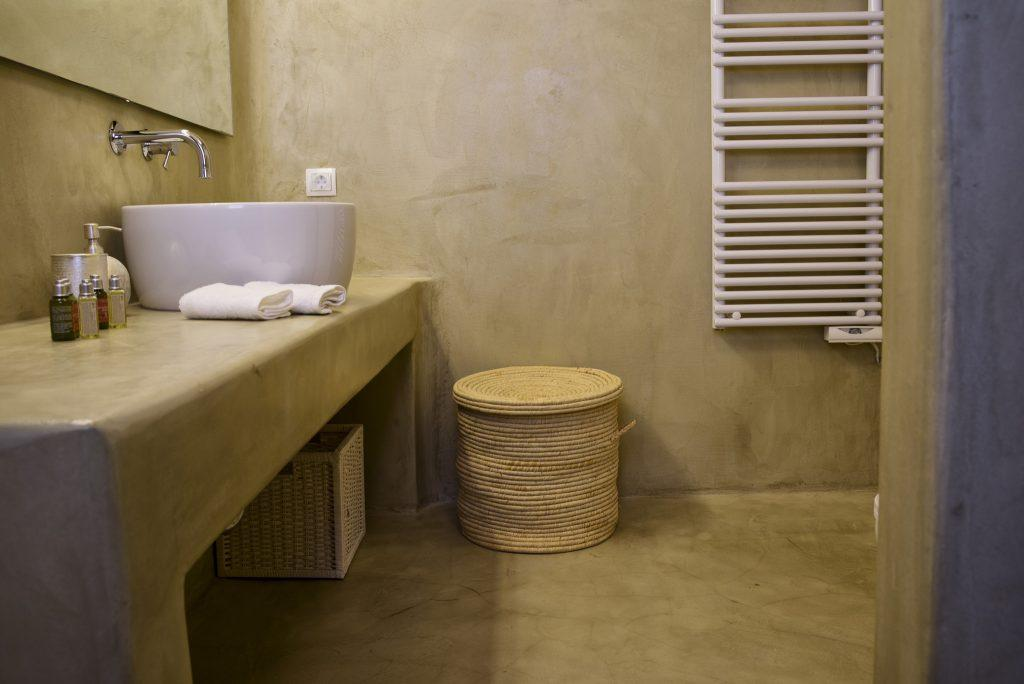 modern designed bathroom for washing and cleaning with towels