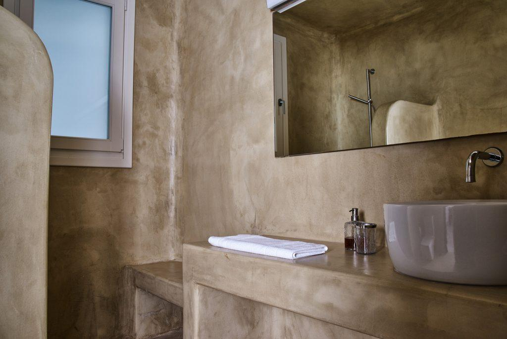 luxurious bathroom with square mirror and ceramic sink