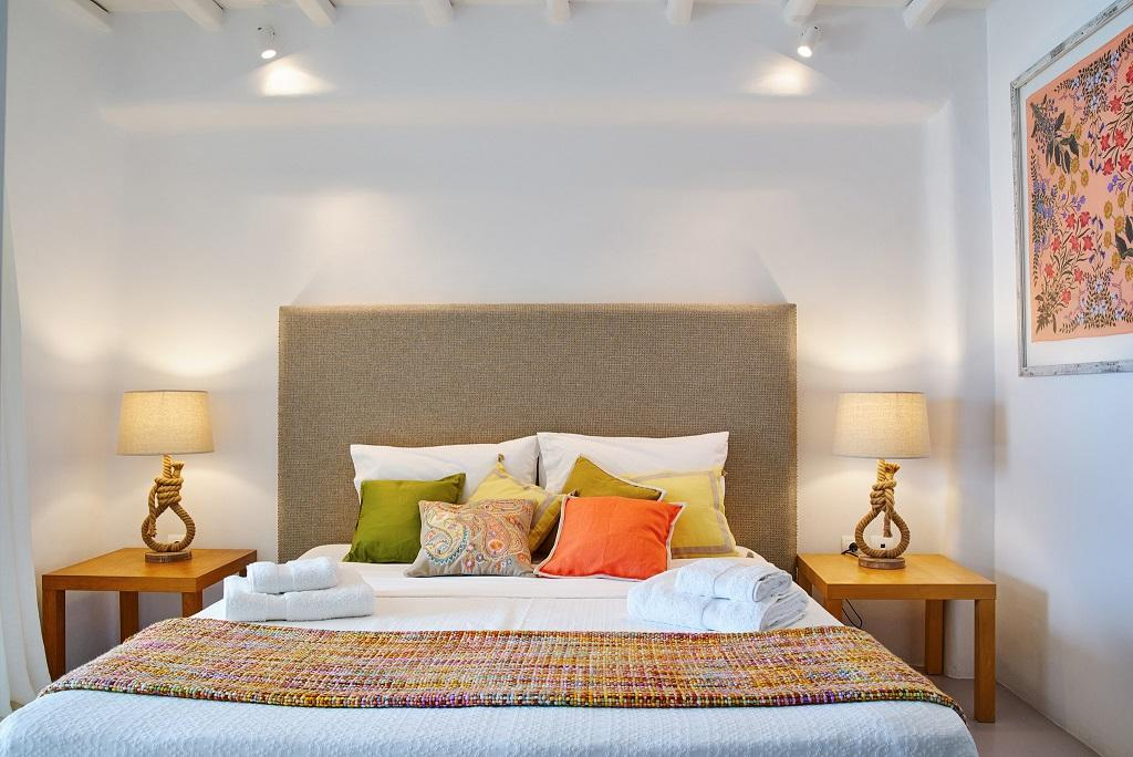 simple designed bedroom with white walls and soft pillows