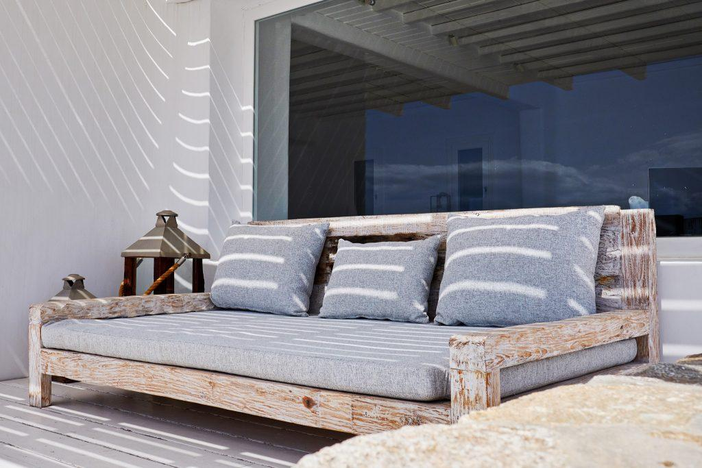 outdoor area with big sofa and soft pillows for relaxing away from the sun
