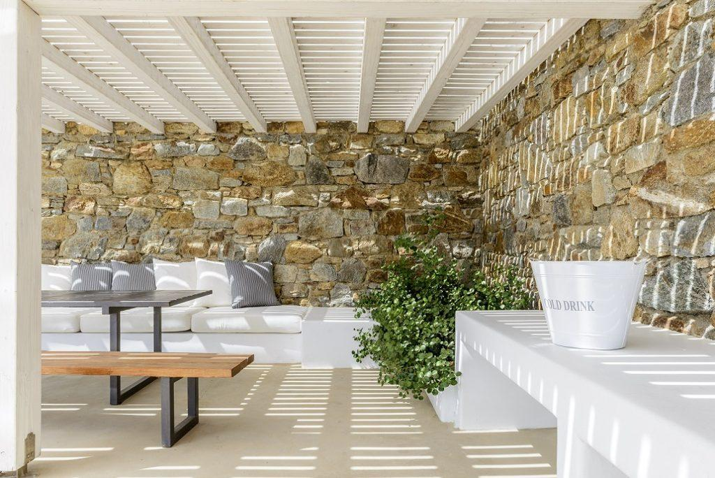 outdoor area with bench and soft pillows for gatherings with friends and family