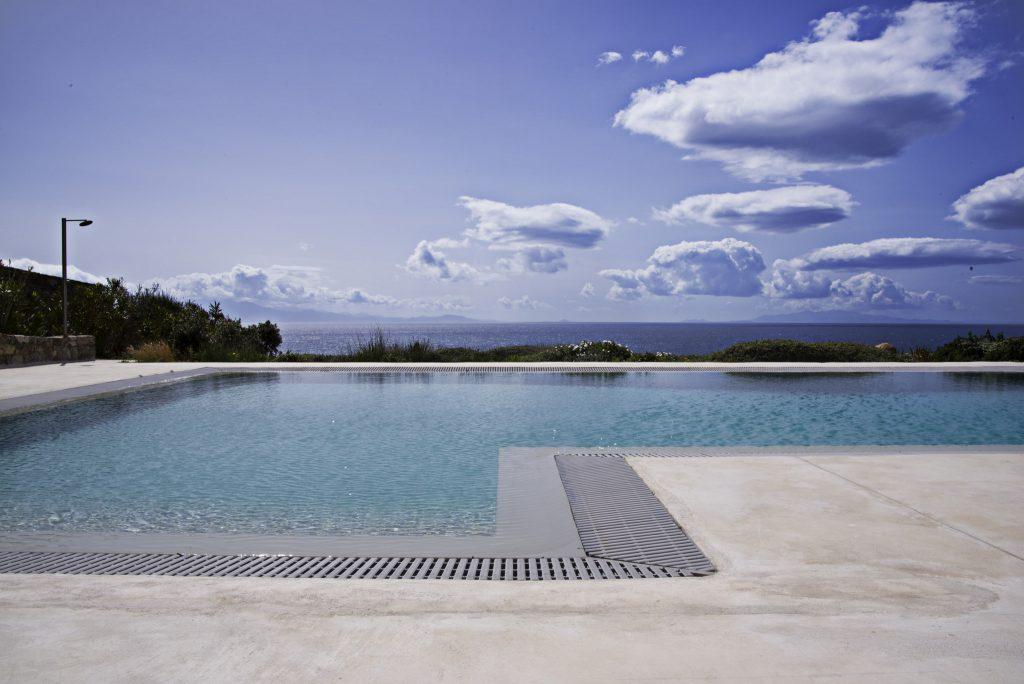 outdoor area with pool and beautiful horizon view