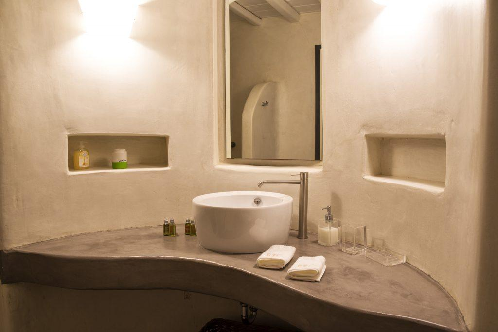 modern designed bathroom with square mirror and ceramic sink
