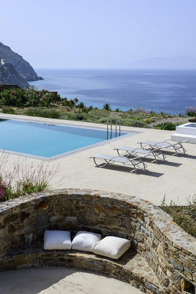 outdoor area by the pool with beautiful sea view