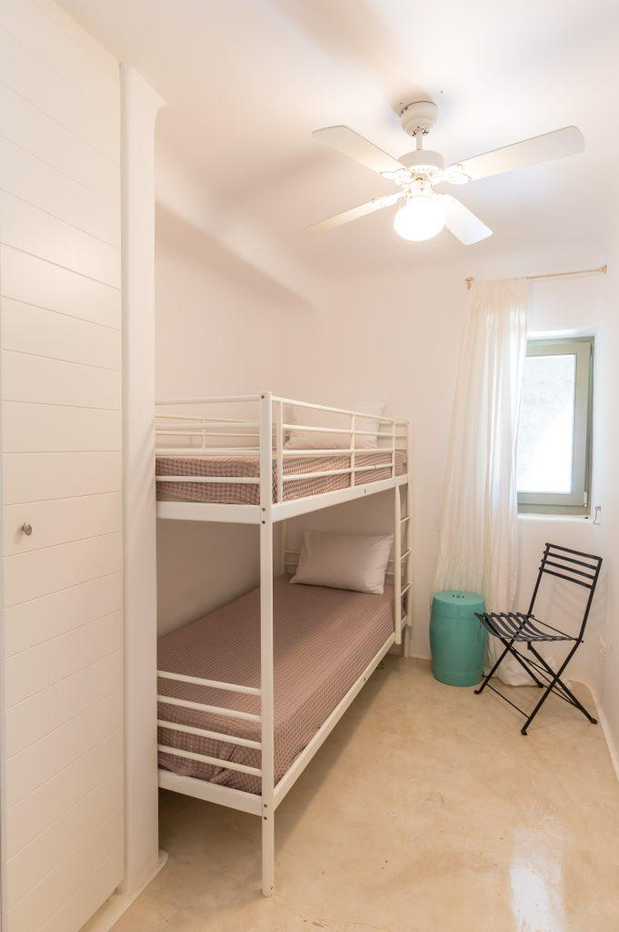 simply designed bedroom with bunk bed