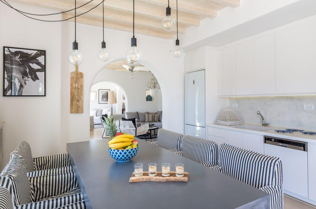 dining area with hanging lamps and table