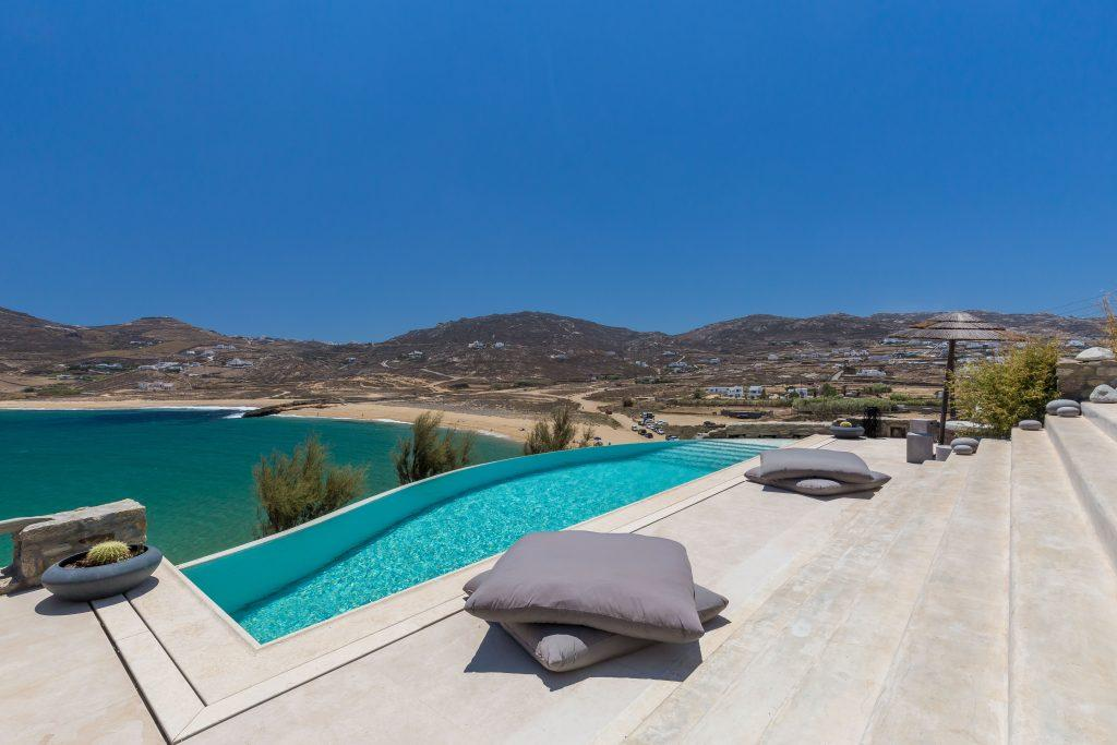 outdoor area with pool and comfortable grey pillows