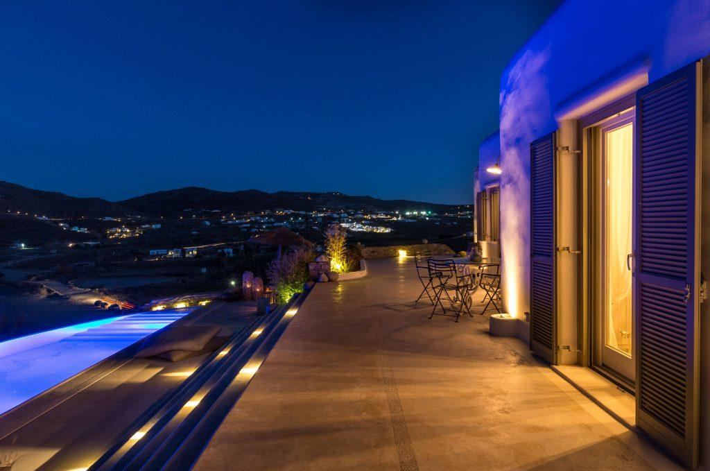stunning outside view with illuminated pool