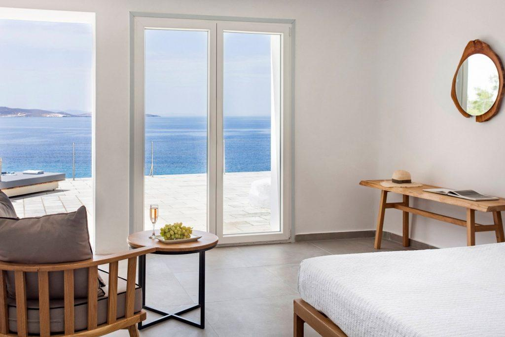 simple designed bedroom with wooden table and horizon view