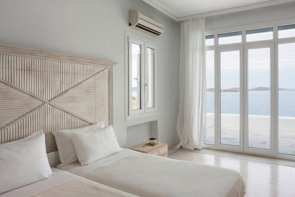 white wall bedroom with satisfying sea view
