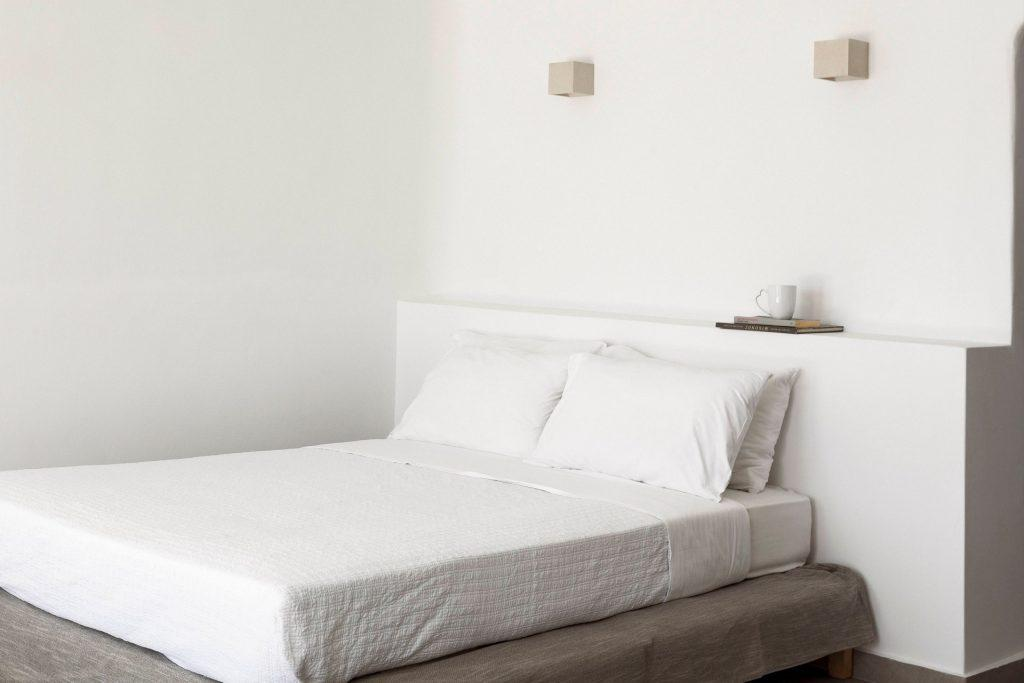 cozy bedroom with white sheets and soft pillows