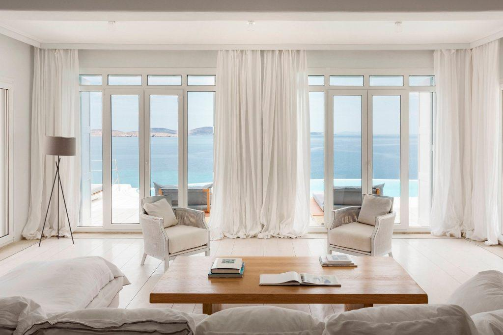 living room with cozy sofa with satisfying sea view