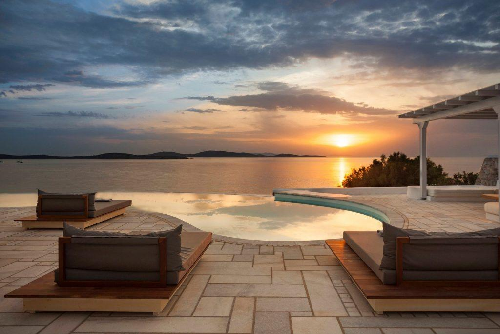 pool area with sunbeds for sunbathing with beautiful sunset view