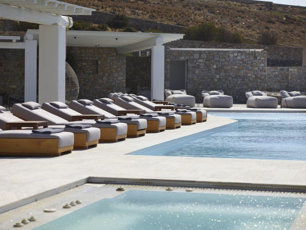 extra comfortable sunbeds to get a perfect tan in Mykonos sun