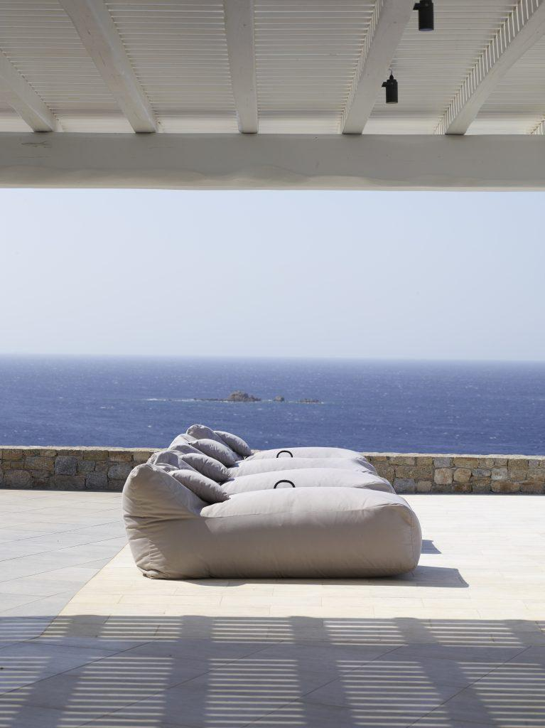stunning view of sea horizon and cozy sunbeds to lay down