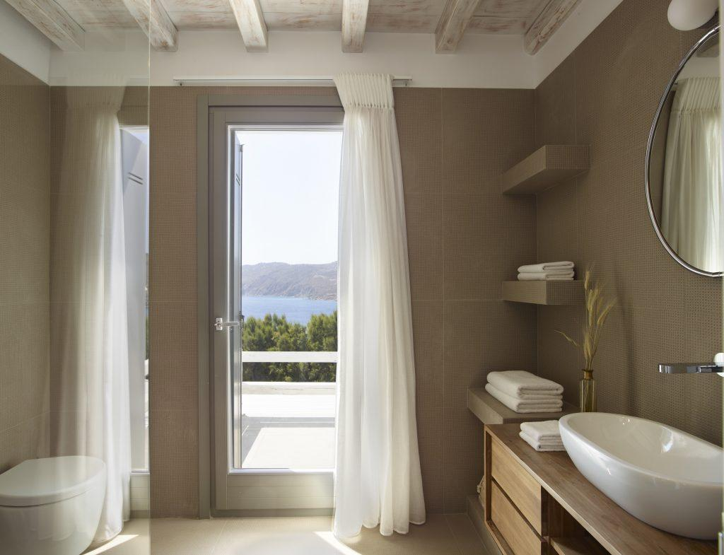 stylish and simple bathroom with natural daylight from wall window