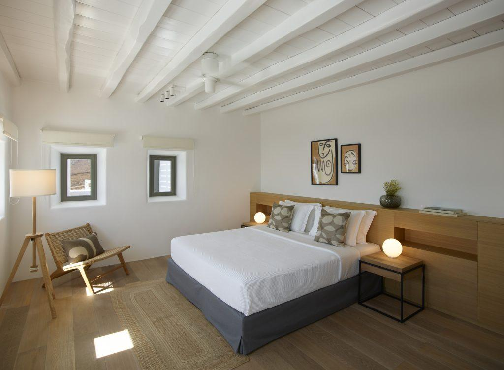 bedroom with cozy high comfortable mattress bed night lamps for resting after a long day