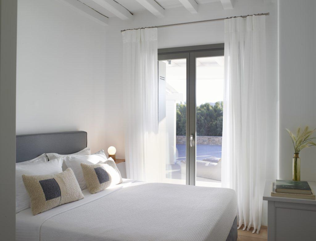 bright simple bedroom with exit to the swimming pool