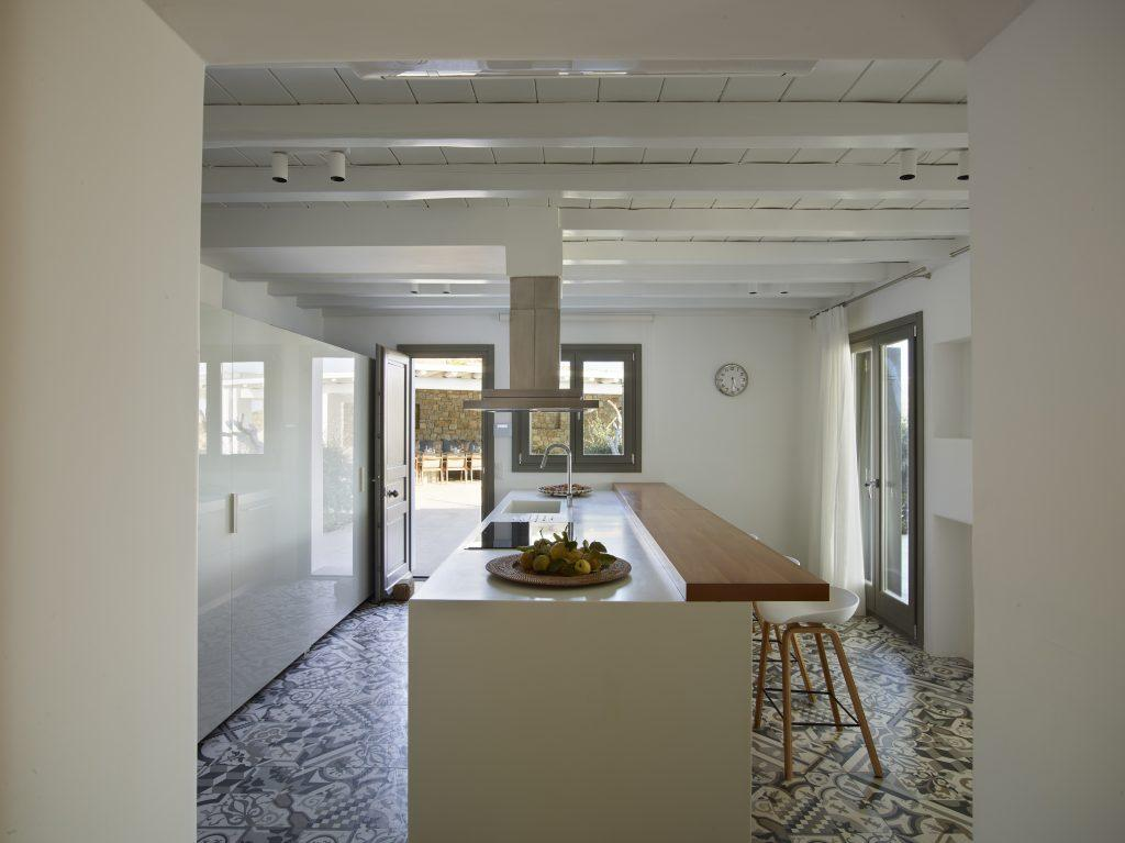 applied layout kitchen with furniture integrated table elevated chairs and windows for natural airing and lightening