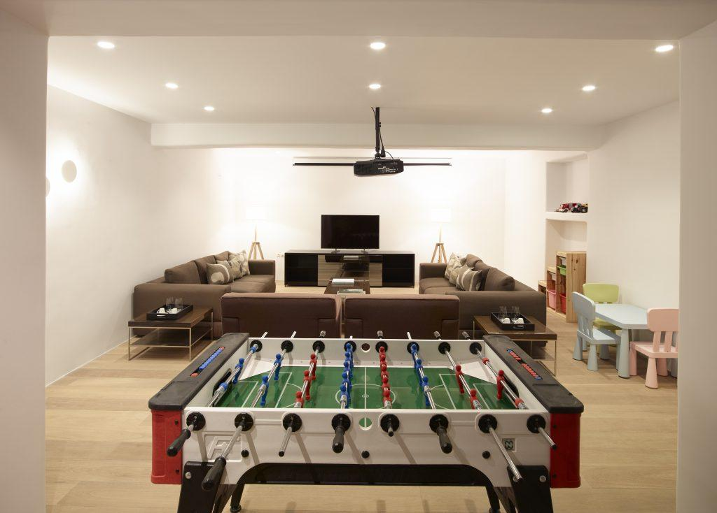 perfect place to hang out with your friends with enough room on sofas watching movie playing table football while kids play over their small table and chairs