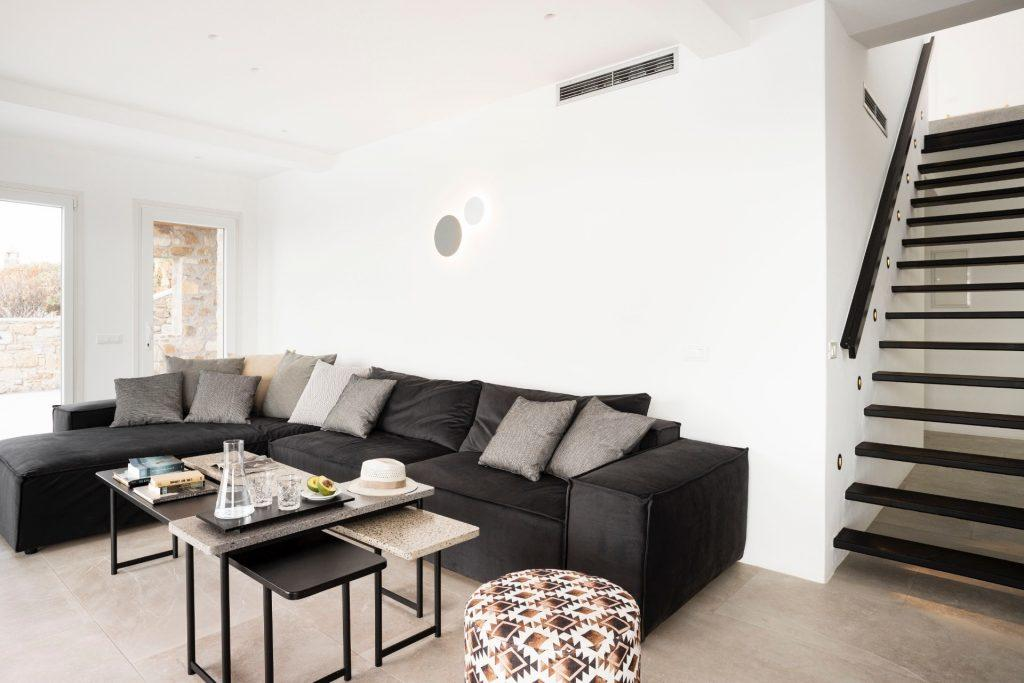 living area with comfort couch and ceramic table